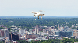Image of drone over city