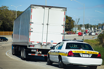 Police Behind Tractor Trailer