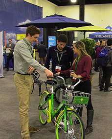 photo of people with electric bicycle